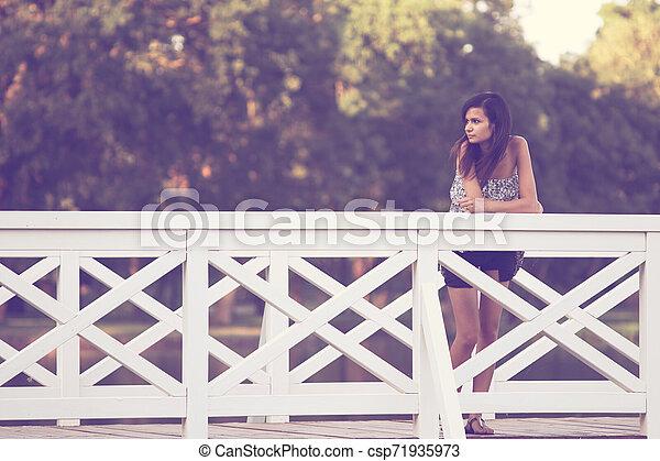 Girl on bridge - csp71935973