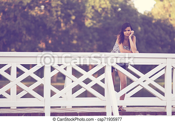 Girl on bridge - csp71935977