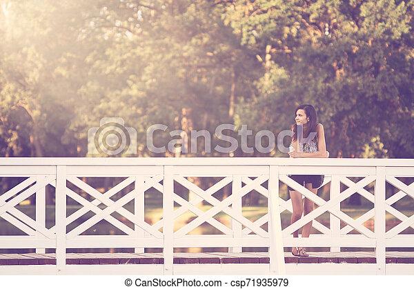 Girl on bridge - csp71935979