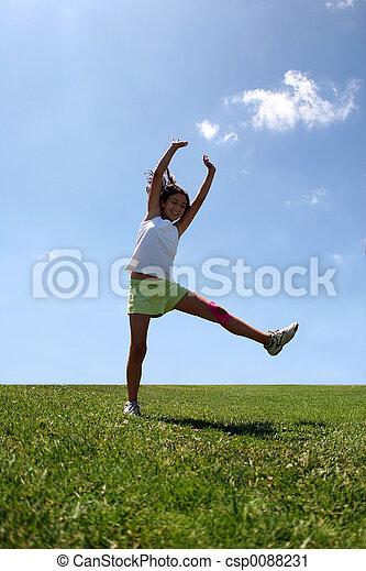 Girl on grass - csp0088231
