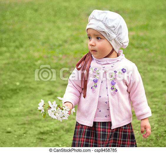 girl on green grass - csp9458785