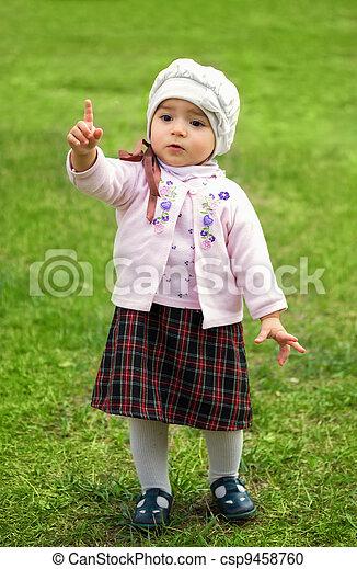 girl on green grass - csp9458760