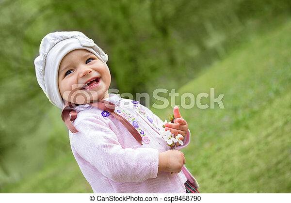 girl on green grass - csp9458790