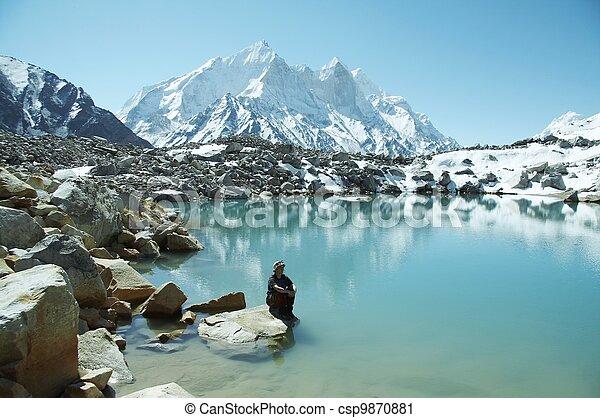 Girl on mountain lake - csp9870881