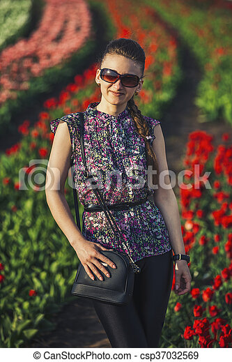 girl on the background of tulips - csp37032569