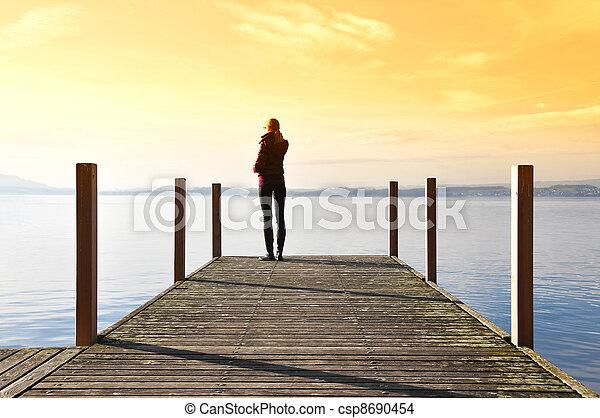 Girl on the pier. Lake of Zug, Switzerland - csp8690454