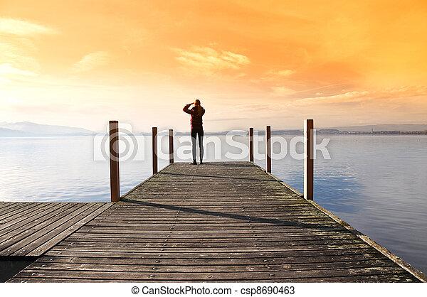 Girl on the pier. Lake of Zug, Switzerland - csp8690463