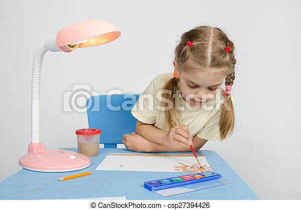 Girl paints sitting at the table - csp27394426
