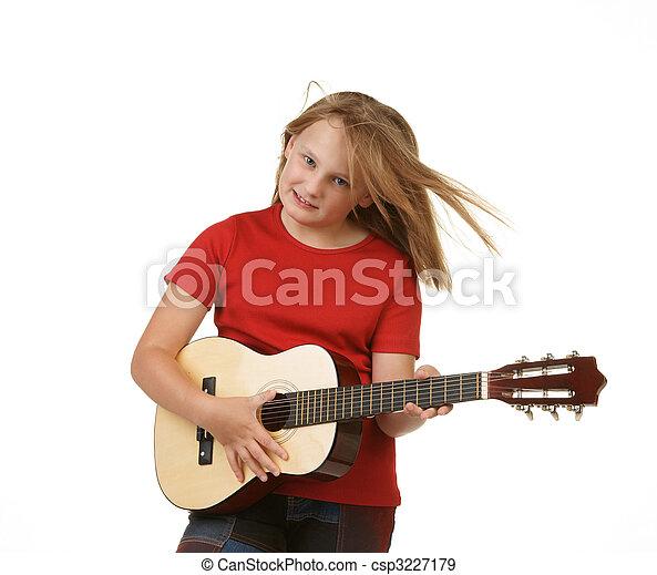 girl playing guitar on white - csp3227179