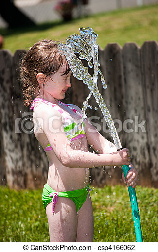 Girl playing outside with water on the summer - csp4166062