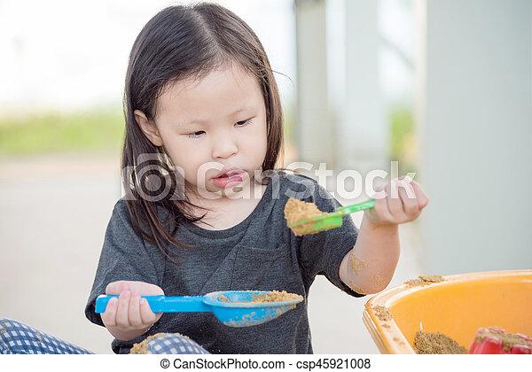 girl playing sand in sandbox - csp45921008