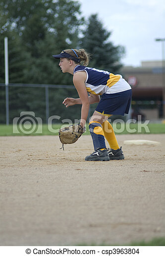 Girl Playing Second Base on Softball Field - csp3963804