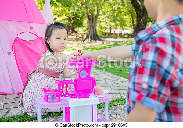 girl playing with her brother in park - csp42910605
