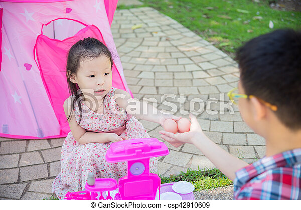 girl playing with her brother in park - csp42910609