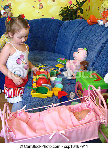 girl playing with toys in her room - csp16467911