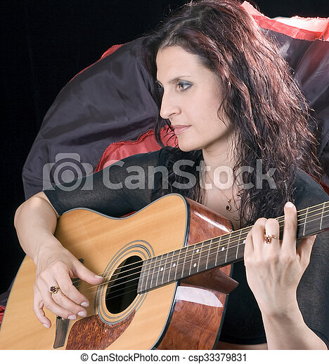 girl plays a guitar girl in red black spanish clothes plays a guitar