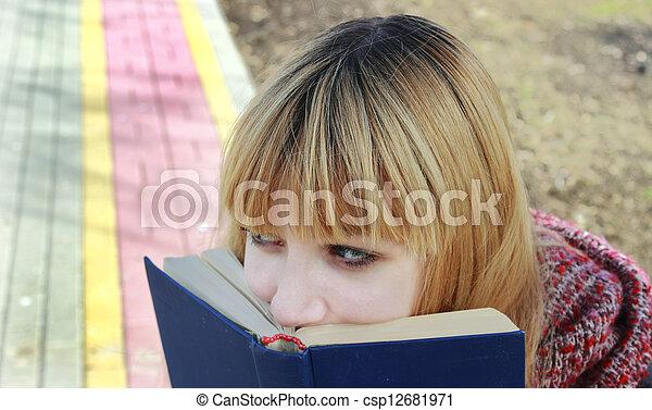 girl reading a book - csp12681971
