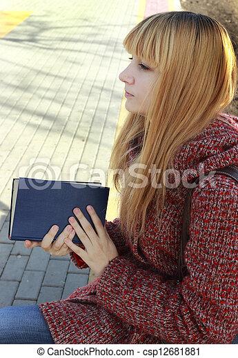girl reading a book - csp12681881