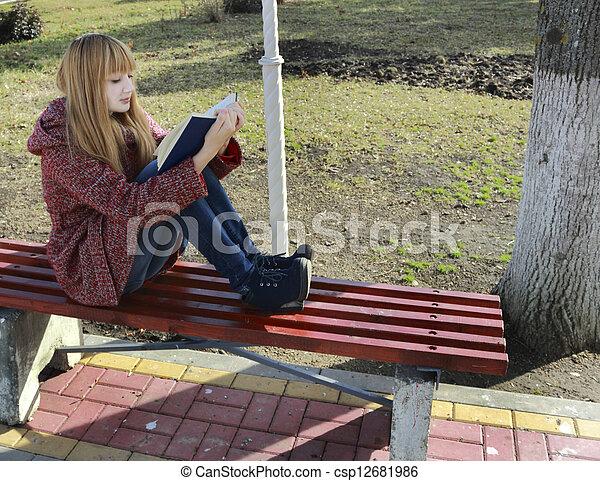 girl reading a book - csp12681986