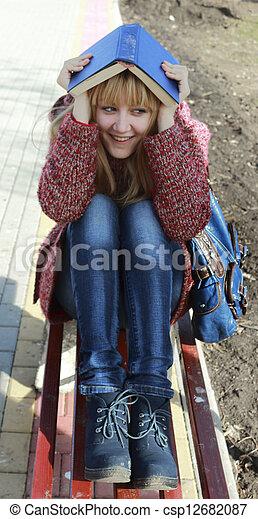 girl reading a book - csp12682087