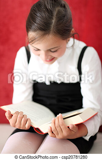 Girl reading a book  - csp20781280