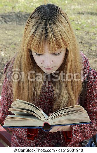 girl reading a book - csp12681940