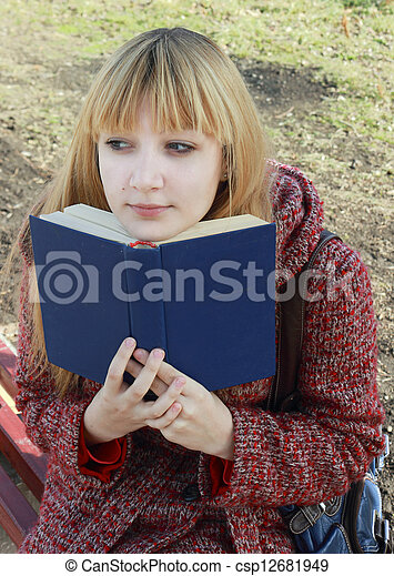 girl reading a book - csp12681949