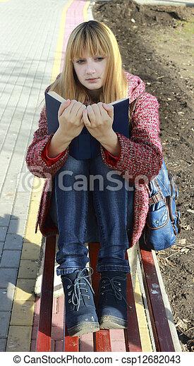 girl reading a book - csp12682043