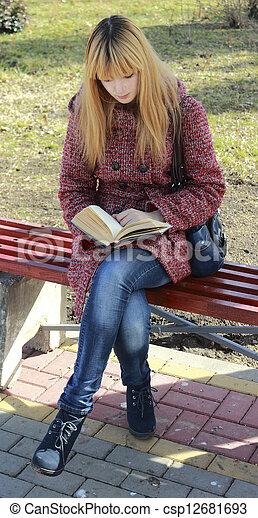 girl reading a book - csp12681693