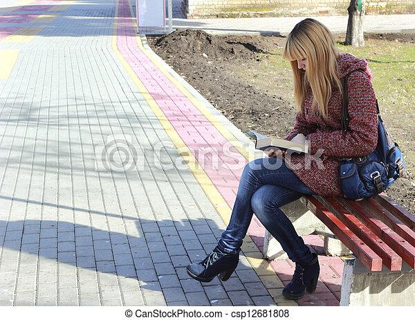 girl reading a book - csp12681808