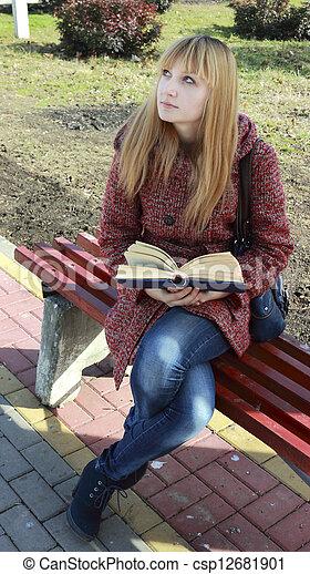 girl reading a book - csp12681901