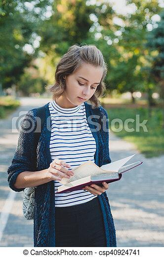 Girl reading book - csp40924741