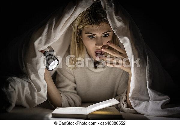 Girl Reading Horror Book