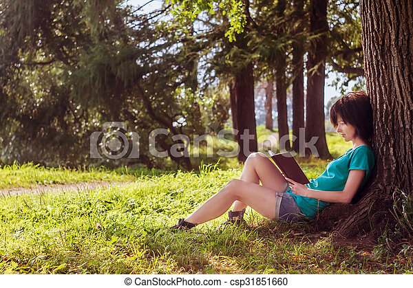 Girl reading in the nature - csp31851660