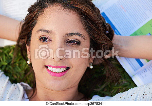 girl relaxing on grass - csp36783411