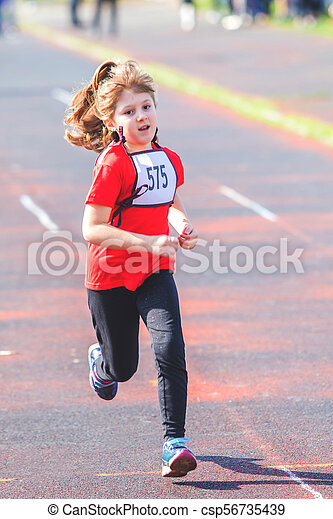 girl running during a race - csp56735439