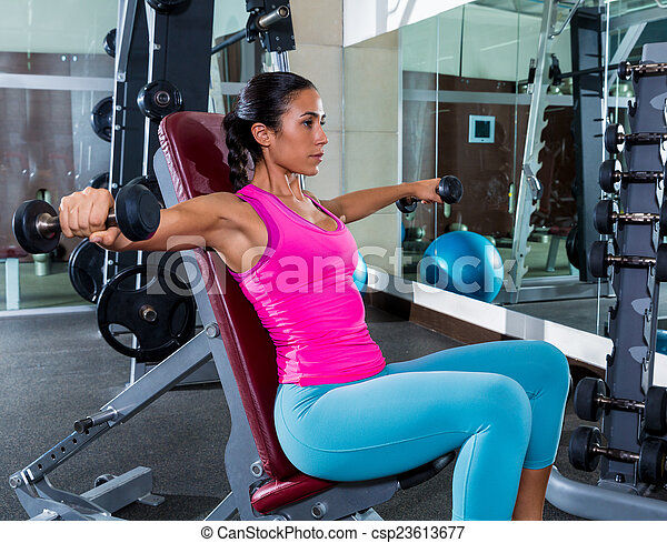 girl seated dumbbell shoulder flies fly workout - csp23613677