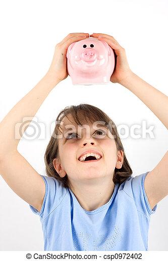 Girl shaking a piggy bank - csp0972402