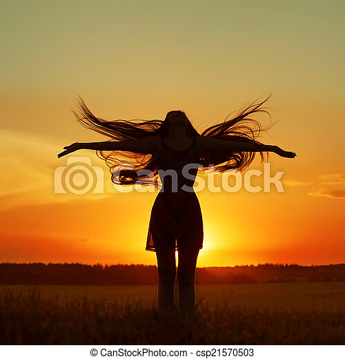 girl silhouette in the field - csp21570503