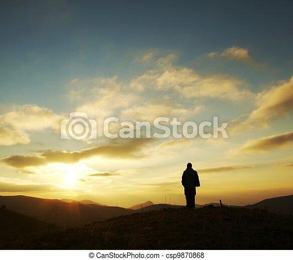 Girl silhouette on sunrise - csp9870868