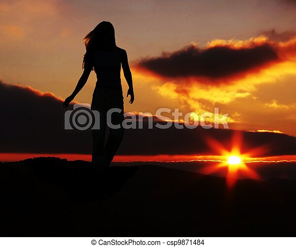 Girl silhouette on sunset - csp9871484