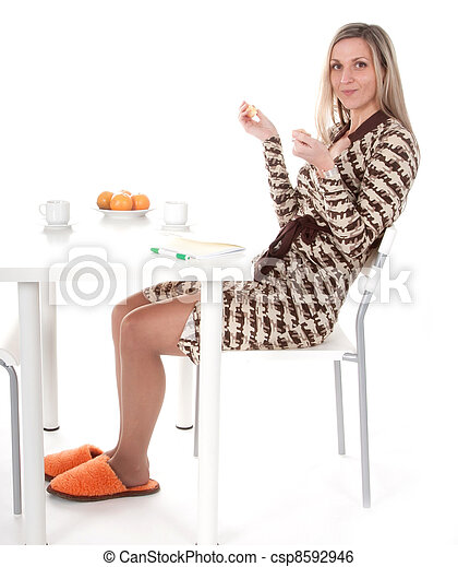 Girl sits at the table - csp8592946