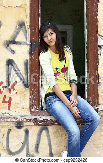 Girl sits on the window sill - csp9232426