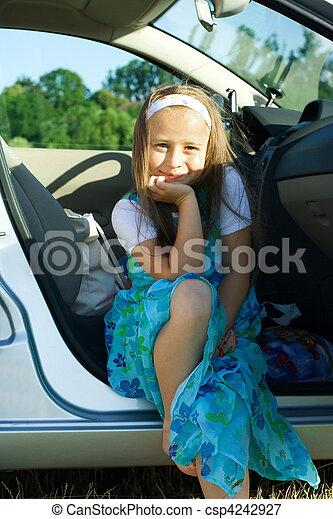 Girl sitting in car. Little girl sitting on car\\\'s seat, summetime ...