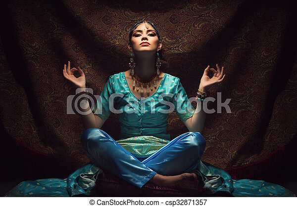 girl sitting in lotus position beautiful young woman