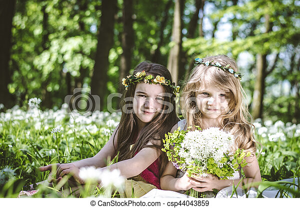 girl sitting in spring meadow - csp44043859