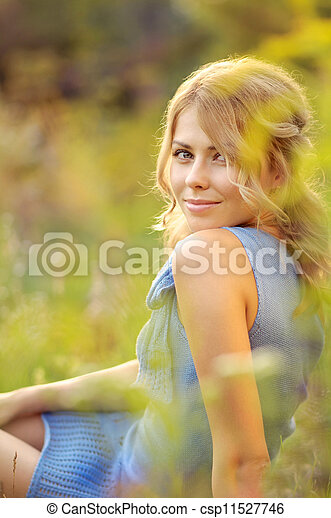 Girl sitting in the grass - csp11527746