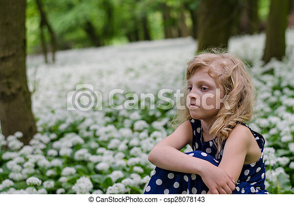 girl sitting in white meadow - csp28078143