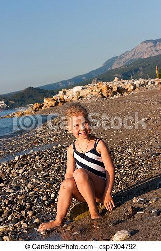 girl sitting on a beach - csp7304792