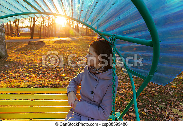 girl sitting on a bench - csp38593486